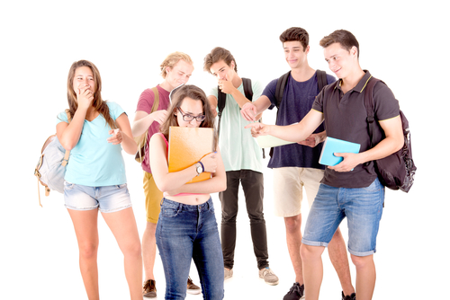 teenagers bullying another isolated in white